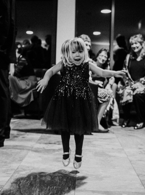 Little girl jumping for joy