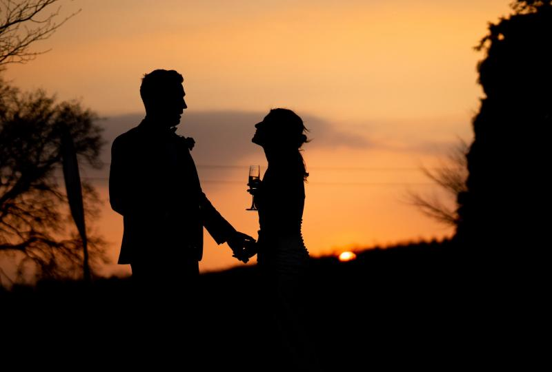 Couple sharing a drink at sunset
