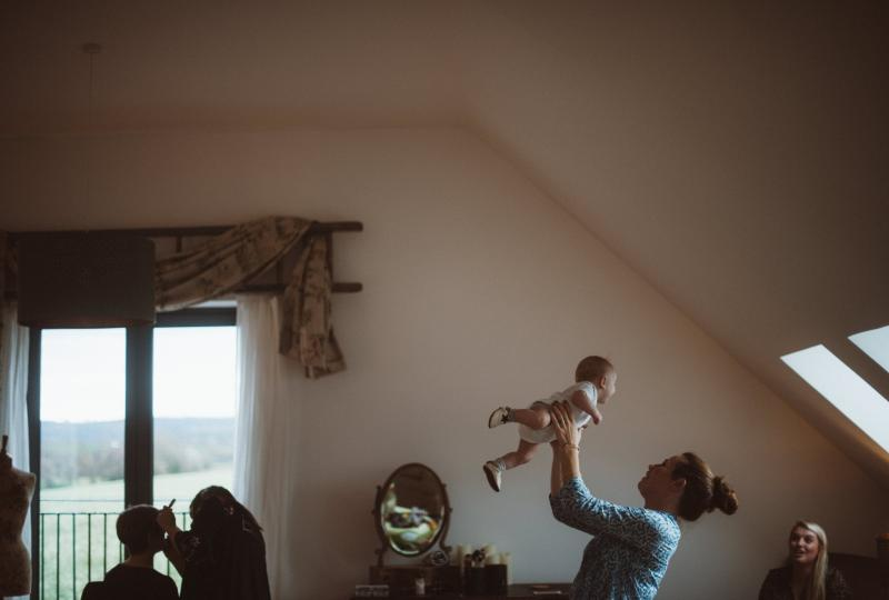 Baby being held high in the Leveret Suite
